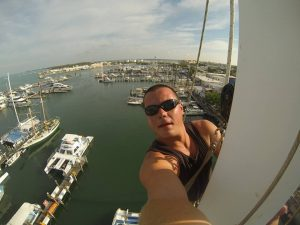 Kamil at the top of the mast in Key West