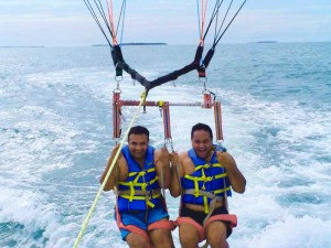 One of Shayne's crystal clear photographs capturing the joy of parasailing