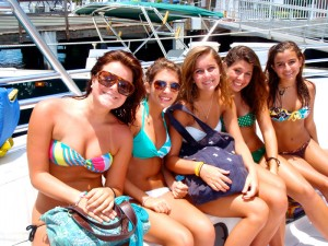 A group of girls on the parasail boat sporting the bandeau bikini fashion.