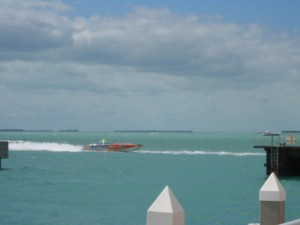 A powerboat zooming through the harbor.