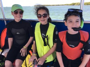 Image of kids getting ready to snorkel