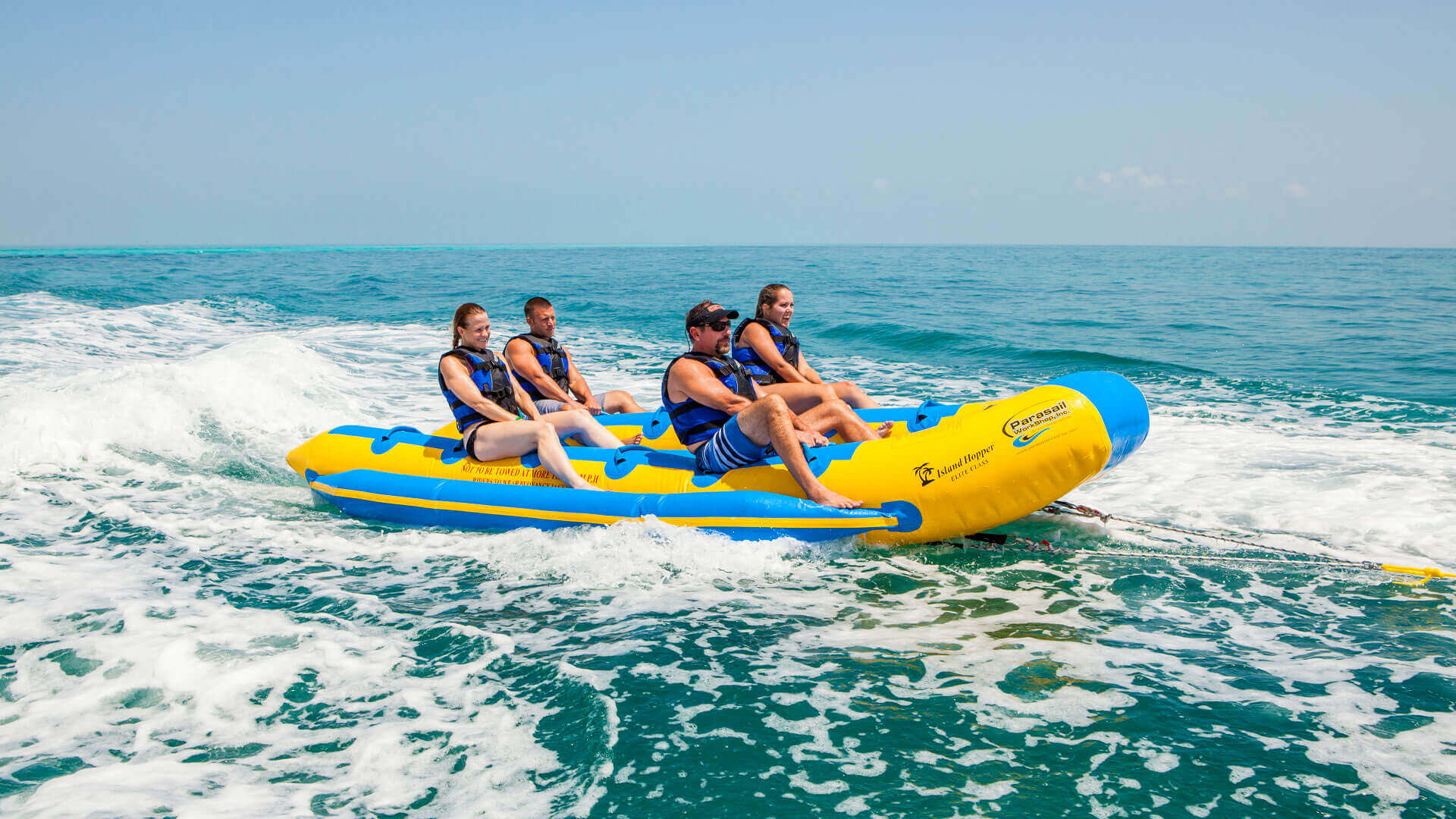 Group of four people enjoy a Fury banana boat ride in Key West