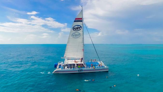 People snorkeling around a Fury catamaran