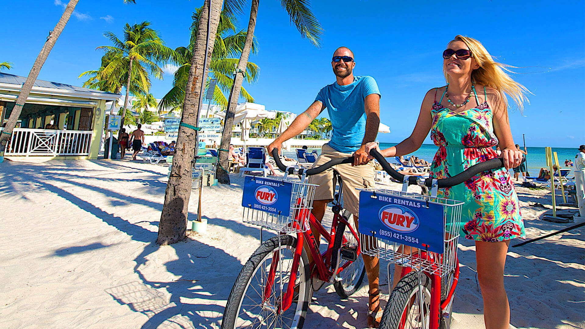 Man and woman biking through Key West