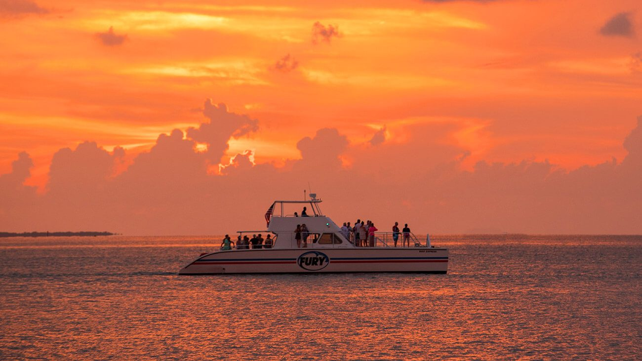 ending the snorkel day with a beautiful orange key west sunset aboard the power catamaran