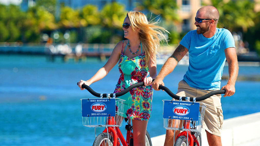 Couple on Fury bike rentals outdoors in key west