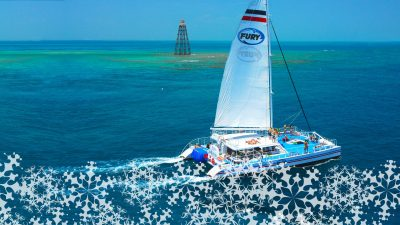 Sailboat in the ocean with snowflakes
