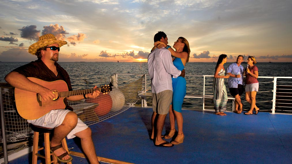 Tourists enjoying a beautiful boat ride in Fury's Commotion on the Ocean sunset sail