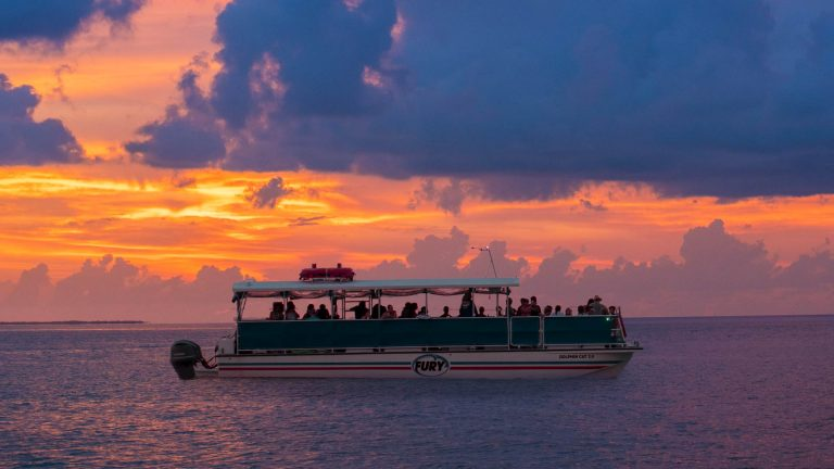 Fury Key West Corinthian Boat out on the ocean during sunset.