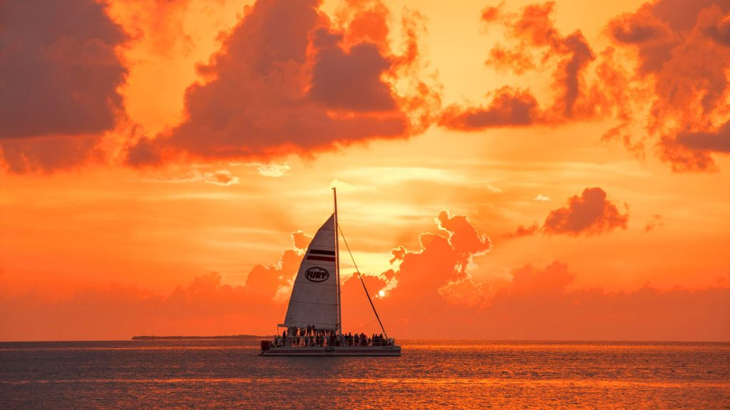Best waterposrt for your vacation starts with the Fury catamaran overlooking the sunset in Key West
