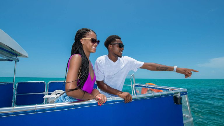 A couple catch a glimpse of a dolphin while enjoying a Fury boat ride