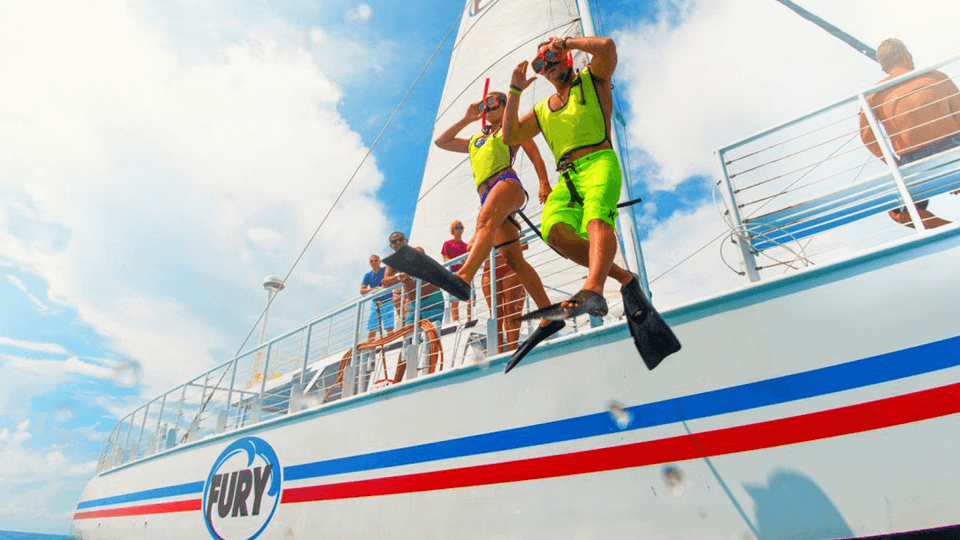 Snorkel couple jumping off a Fury boat in Key West