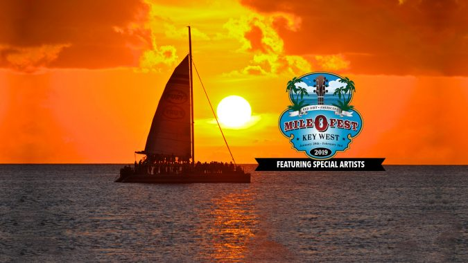 Key West sunset with a Fury Catamaran and the Mile 0 Festival logo