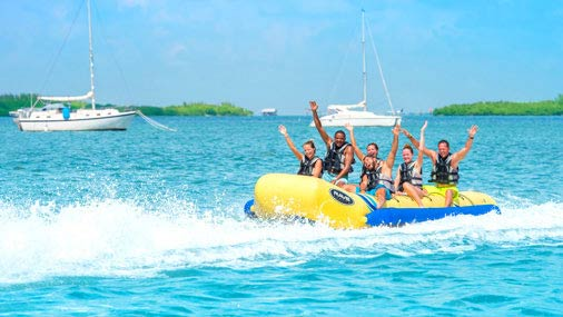 Friends having a blast at Fury's Ultimate Adventure banana boat ride