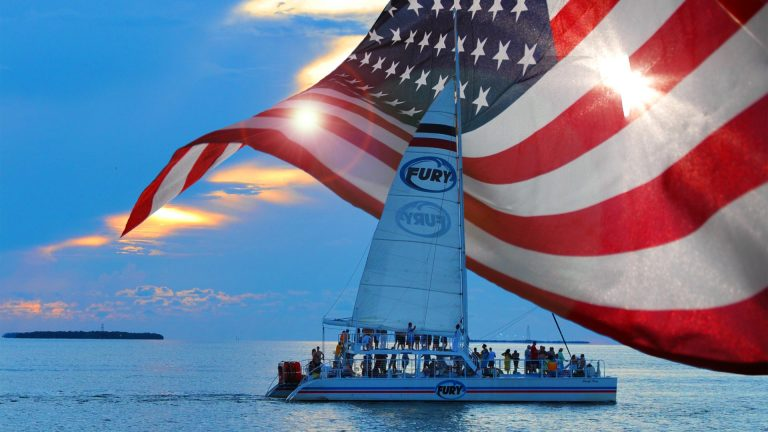 Fury Catamaran during a Key West Sunset with the American Flag