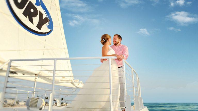 Couple celebrating wedding in Key West aboard Fury catamaran
