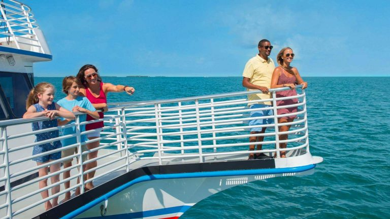 Image of people viewing the Key West waters on a Glass Bottom Boat Tour