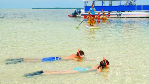 People enjoying various water activities in Key West