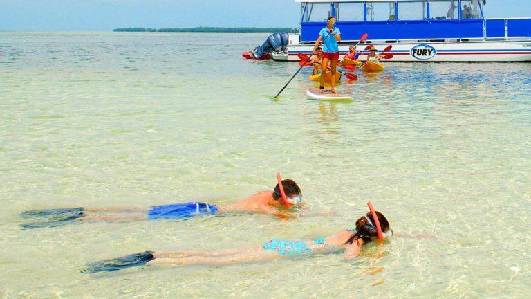 People enjoying various water activities in Key West