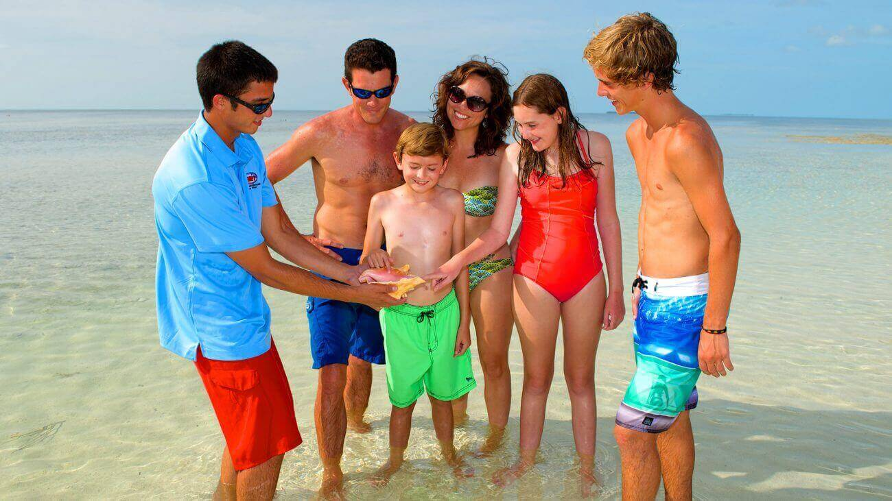 Image of family looking at a conch shell horn in Key West