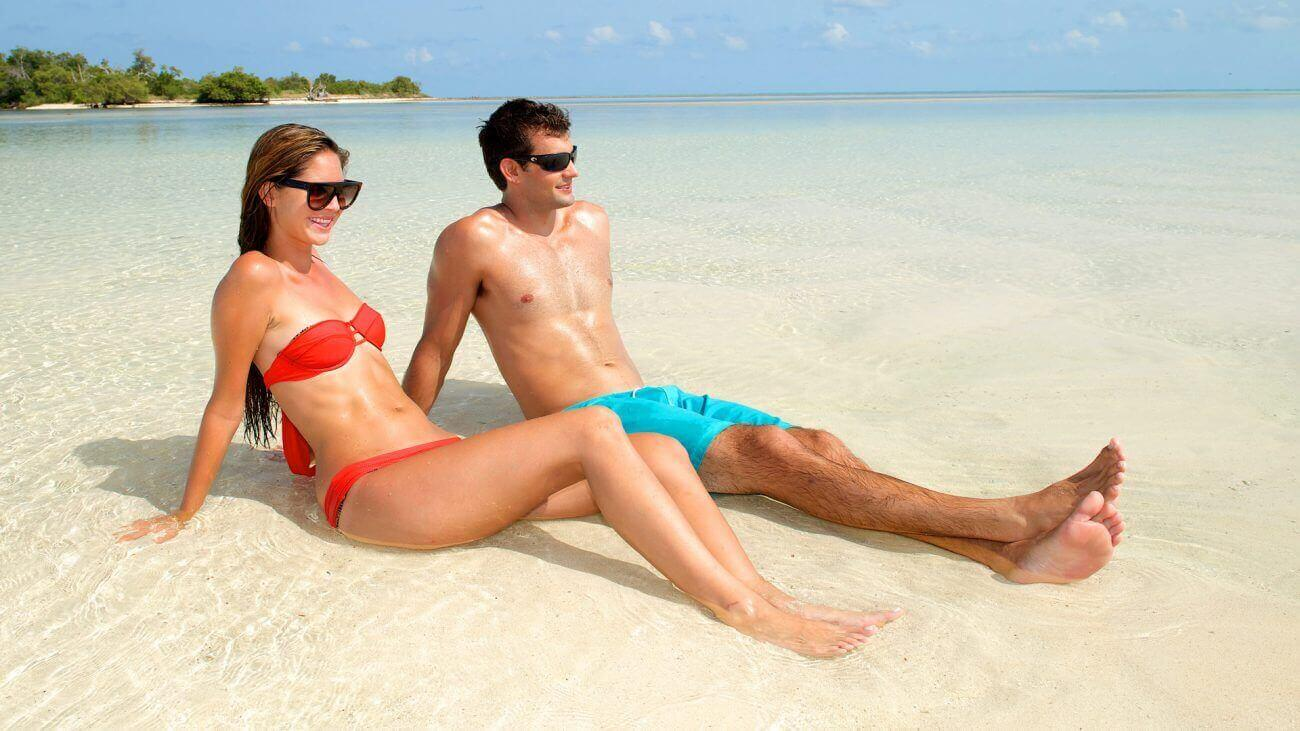 Image of couple laying in the sand in Key West