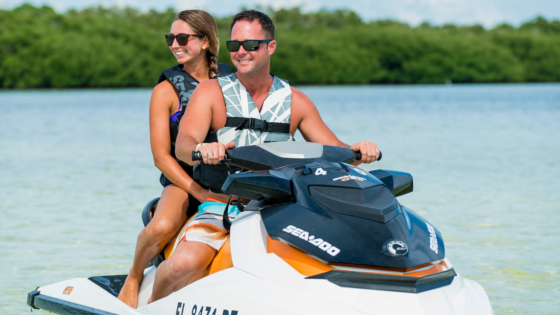 Image of a mother and son riding a jet ski in Key West
