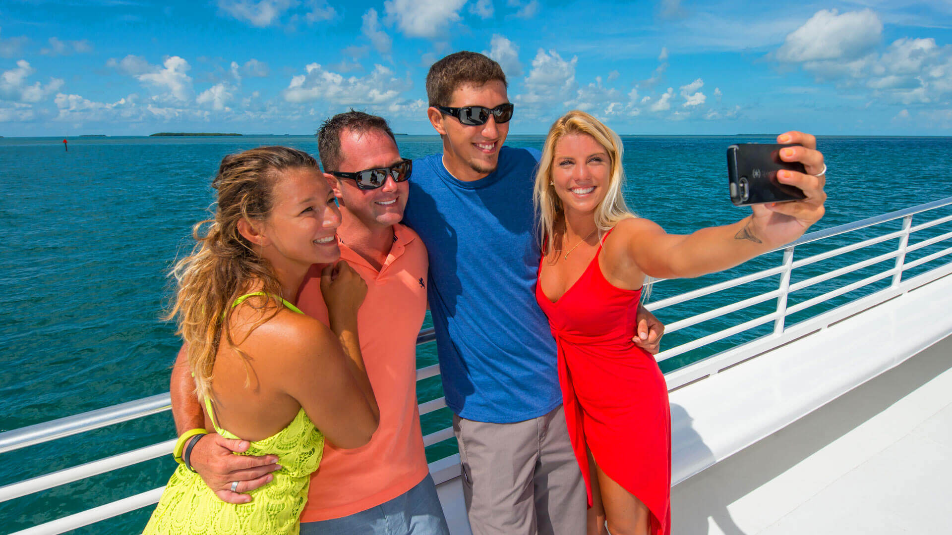 Friends taking a selfie aboard a Fury's catamaran in Key West