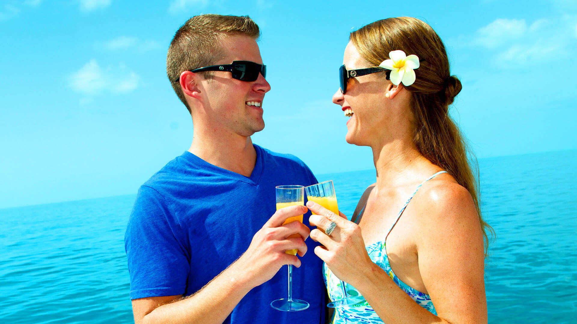 Couple toasting with mimosas in Key West
