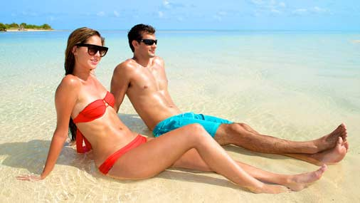 Image of couple relaxing on a Key west sandbar