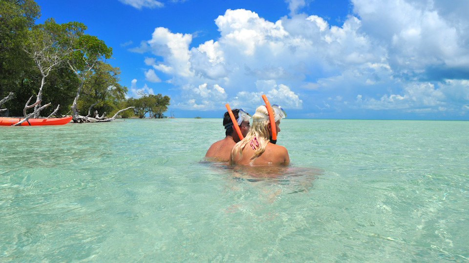Couple taking a break from snorkeling in Key West Island Adventure