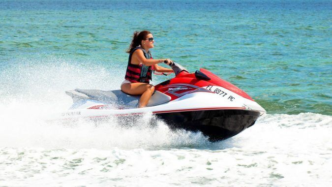 Image of woman riding a jet ski in Key West
