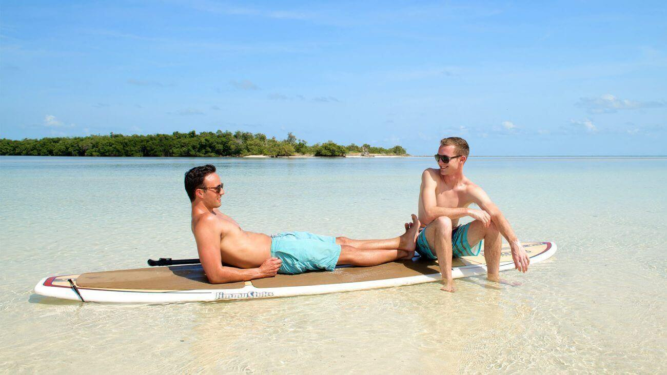 Image of guys relaxing on a paddleboard