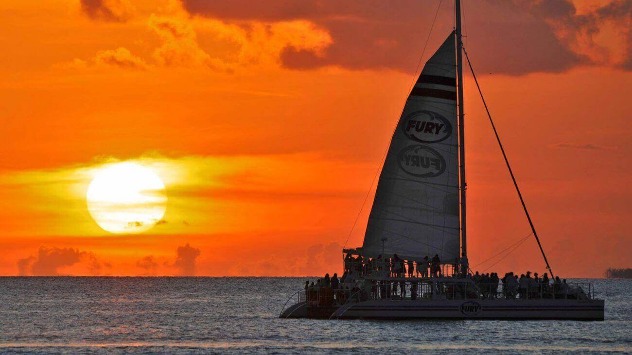 Image of Fury Catamaran with Key West sunset