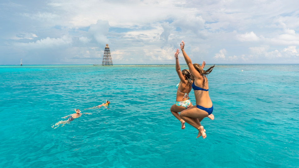 Girls jumping off a Fury boat in Key West