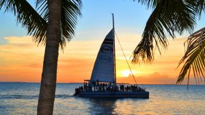 Image of Fury catamaran sailing into Key West sunset