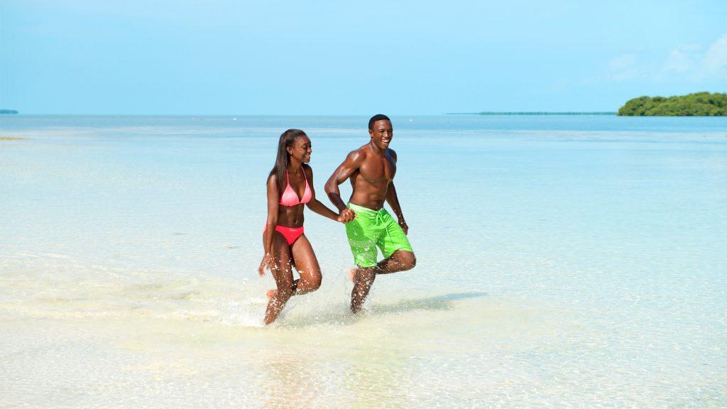 Couple running through the beach