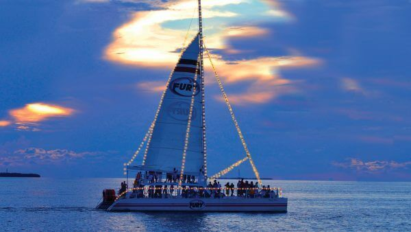 Image of Fury Key West catamaran at dusk