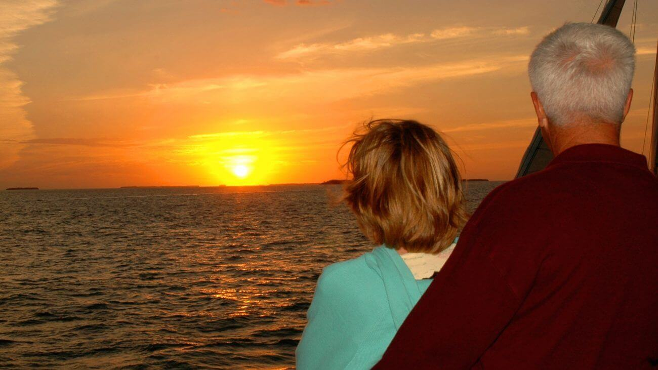 Couple watching the Key West sunset from the Fury Sunset Cruise in Key West