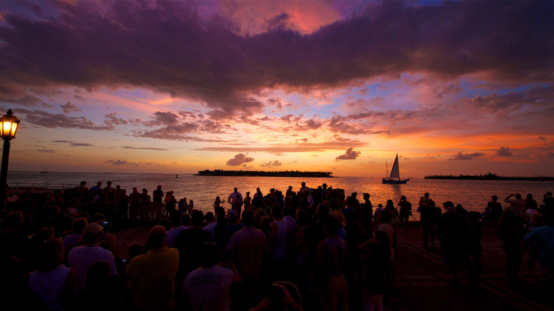 families enjoying the sunset in mallory square in key west