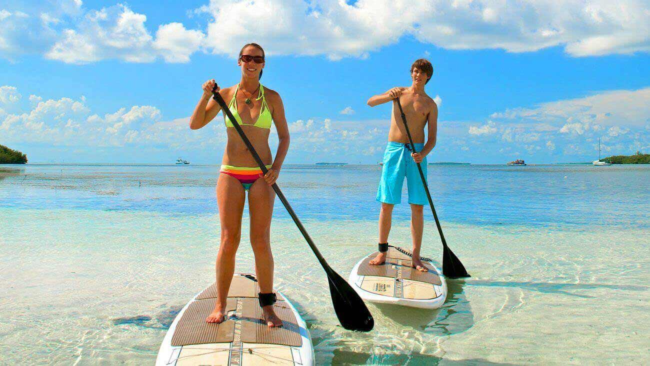 Image of couple paddleboarding in Key West