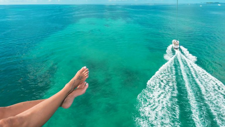 Feet of a woman parasailing in key West