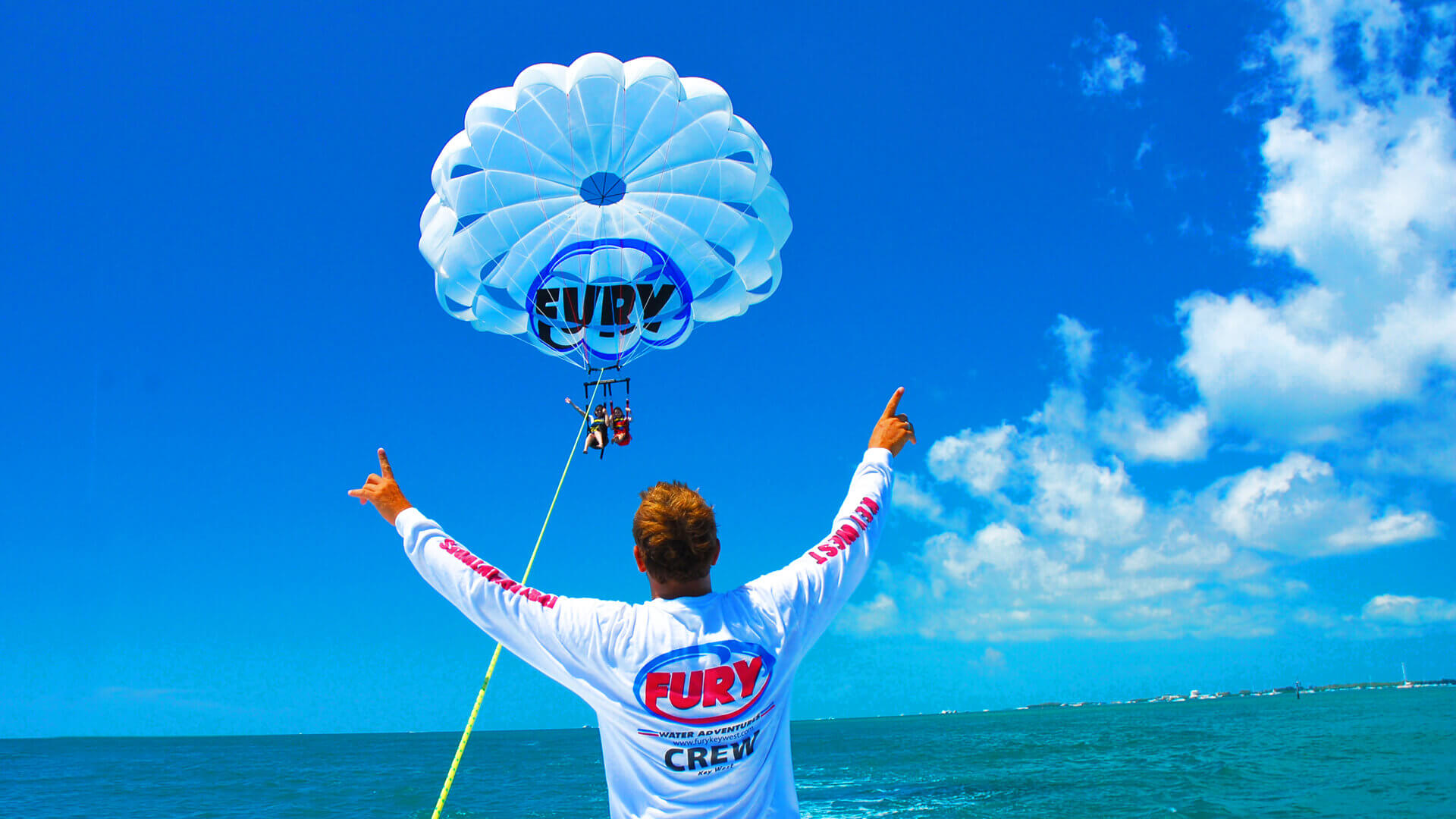 Man standing in front of people on a parasail