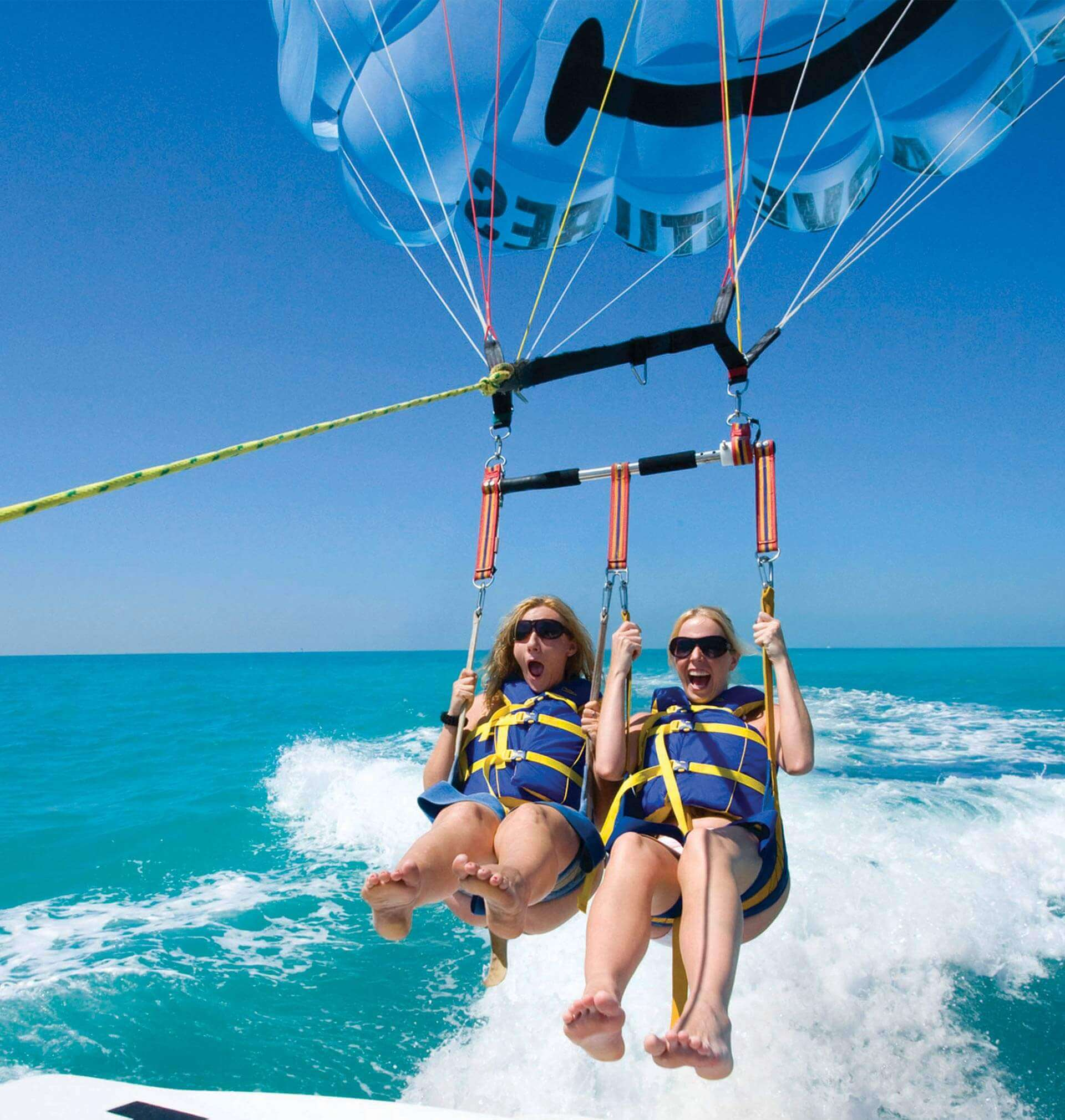Two women enjoying the parasail thrills