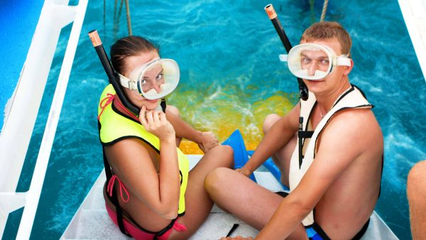 Image of couple getting ready to snorkel in Key West