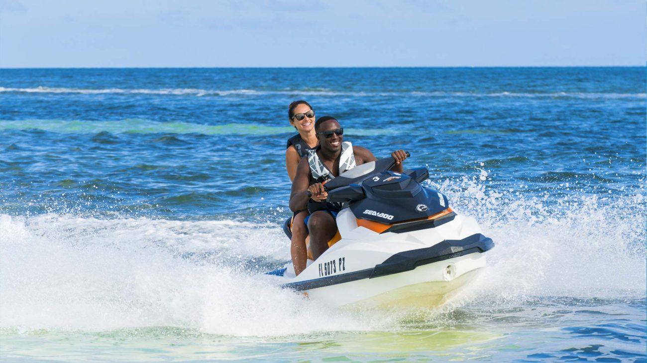 Couple riding a jet ski in Key West