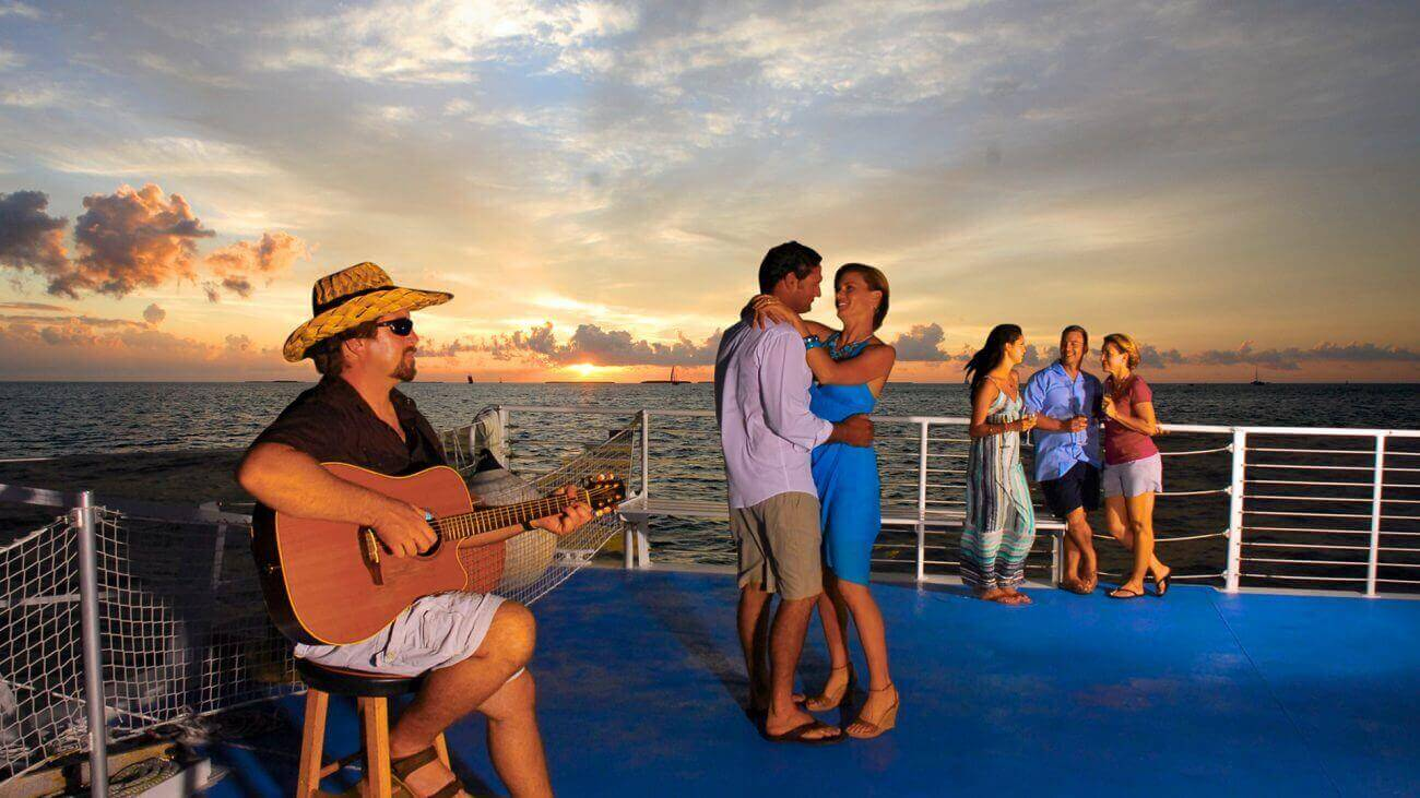Tourists enjoy a sunset sail cruise ride in Key West