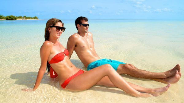 Image of couple relaxing on sandbar in Key West
