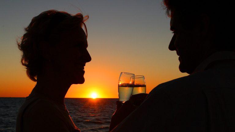 Couple enjoying champagne on the Fury Sunset Cruise