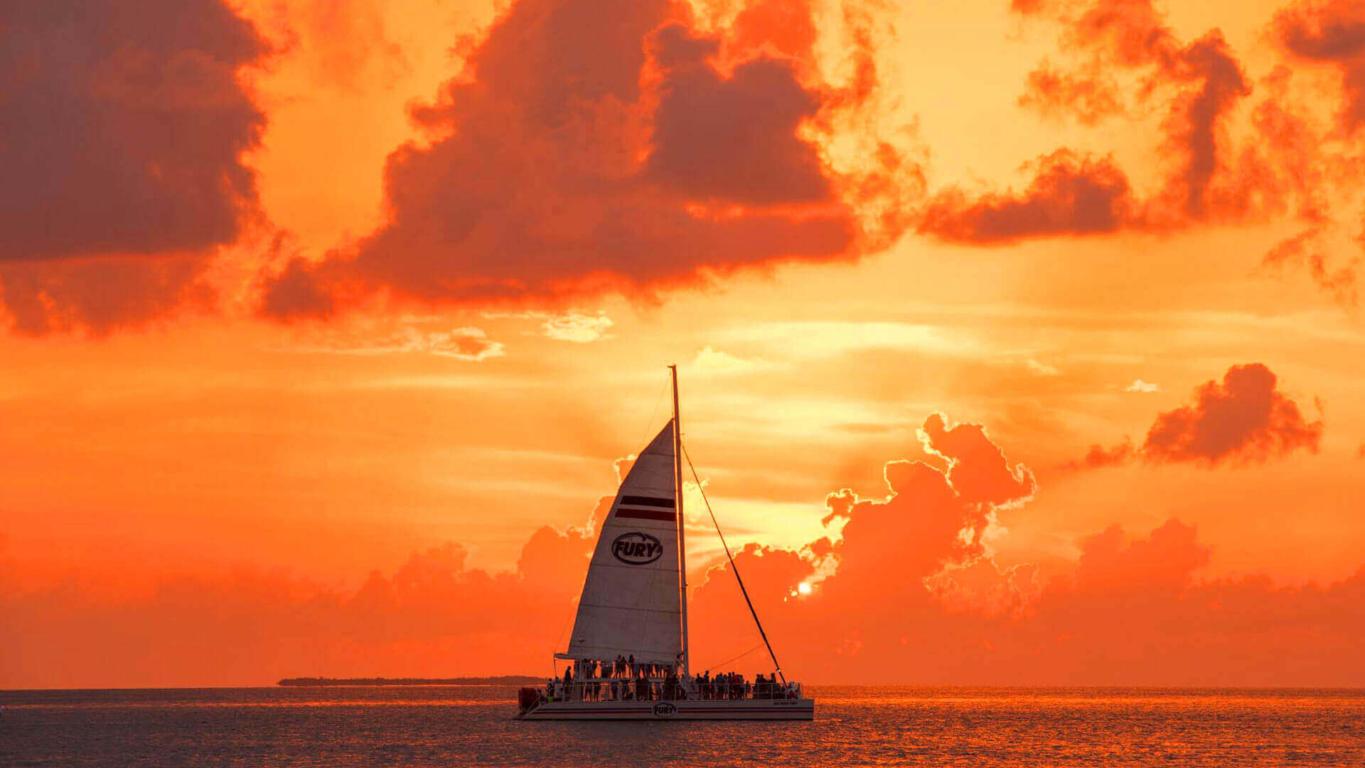 Fury boat with a beautiful orange sunset in Key West