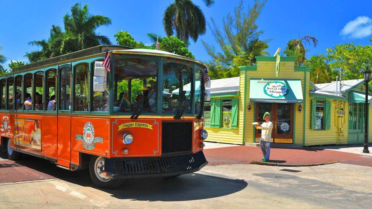 Old Town Trolley Tour passing by a popular street in Key West